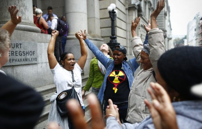 Celebrations outside the Western Cape High Court after it ruled against the South African government's proposed nuclear deal.