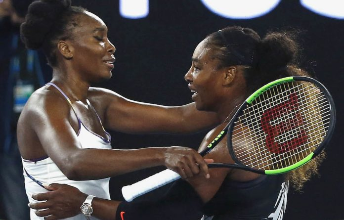 Still doing it for themselves: Sisters Venus and Serena Williams in the final of the Australian Open. Photo: Thomas Peter/Reuters