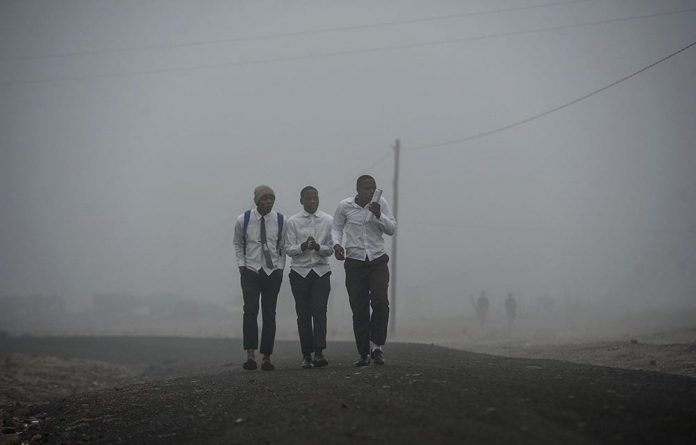 Learners walking to school on a cold winter morning in June 2017.