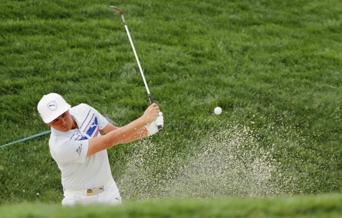 Keep off the grass: Rickie Fowler plays a bunker shot during a practice round prior to the US Open.