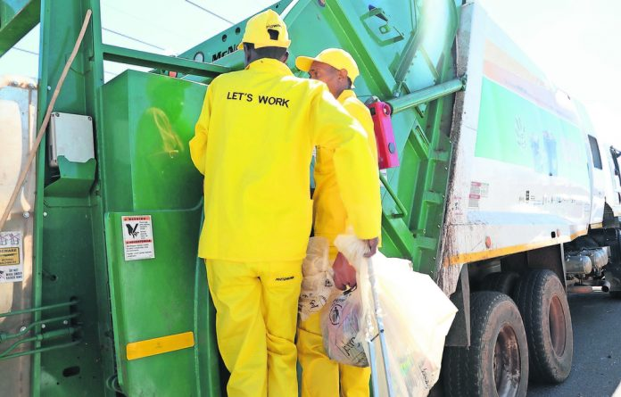The City's workers convey waste to removal trucks