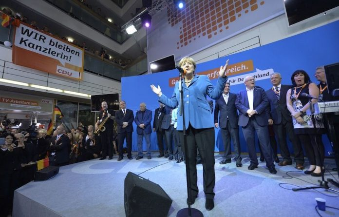 German chancellor Angela Merkel speeches after the first poll results indicated a historic win.