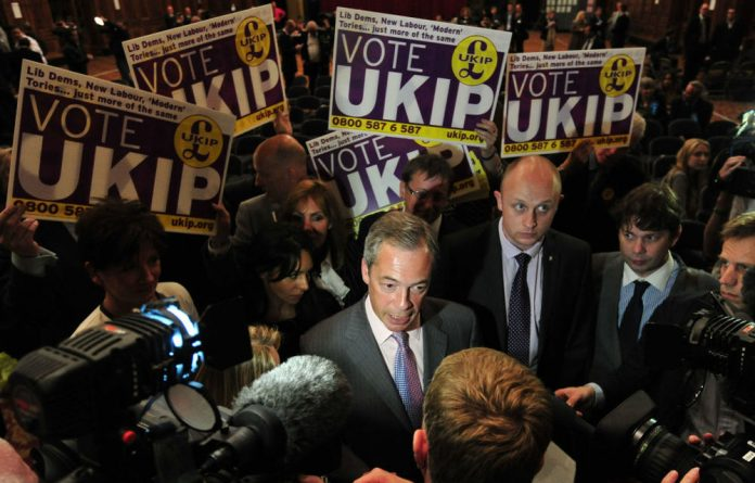 Ukip leader Nigel Farage talks to the media after being re-elected as an MEP in the European Parliament elections.