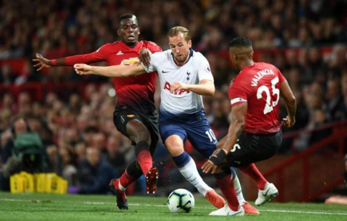 Tottenham Hotspur's Harry Kane battles for possession with Paul Pogba and Antonio Valencia of Manchester United during the match at Old Trafford on August 27. Now he will be up against Liverpool ace Sadio Mané.