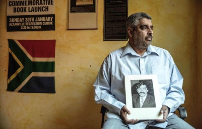 Justice delayed: Imtiaz Cajee holds a portrait of Ahmed Timol. Despite being hamstrung by officialdom