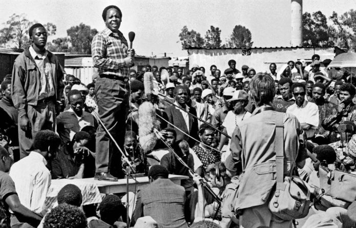 Members of Umkhonto weSizwe carry Hani's coffin at a vigil in Soweto in April 2003.