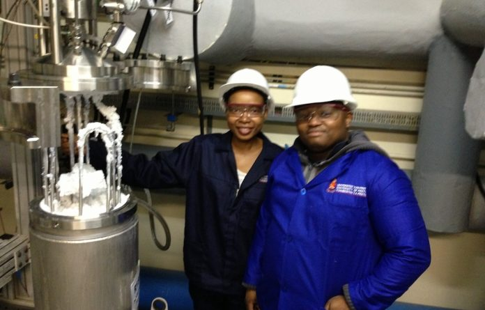Postgraduate students Charlotte Mawela and Tando Kili after a successful run at the multi-purpose fluorination pilot plant at Pelchem.
