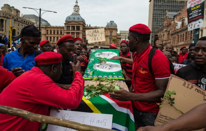 Demonstrators gathered at Church Square in the Pretoria CBD this morning.