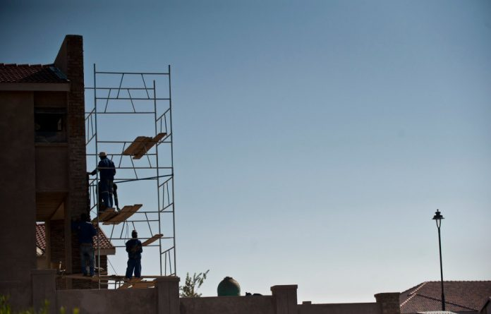 Many informal subcontractors have found work extending houses in areas like Sharpeville.
