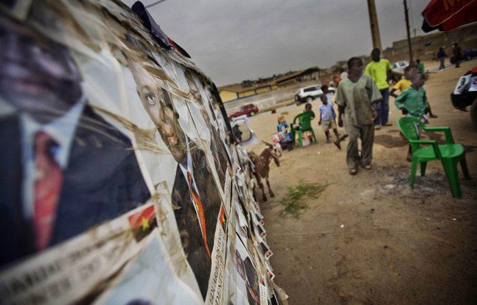 Master manipulator: Posters depict 'quiet' Angolan President José Eduardo dos Santos