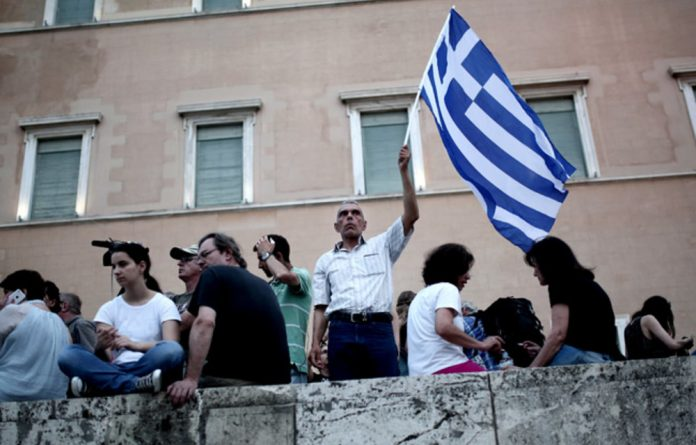 An anti-austerity protester at a demonstration in front of the Greek Parliament in Athens on June 21.