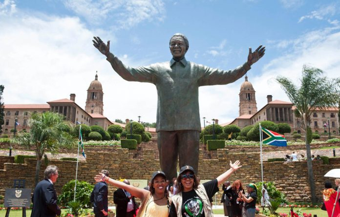 Eleventh hour: The gigantic sculpture of Nelson Mandela was installed at the Union Buildings in Pretoria 19 years after democracy.
