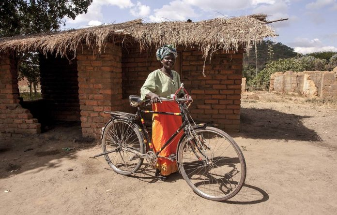 Selovana Phiri was able to buy her bicucle thanks to the Social Cash Transfer Programme.