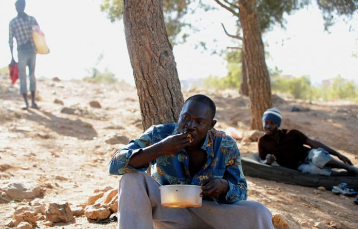 An illegal African immigrant resting at a makeshift camp in the Sidi Maafa woods in Oujda near Morocco's Mediterranean coast on September 10 2012.