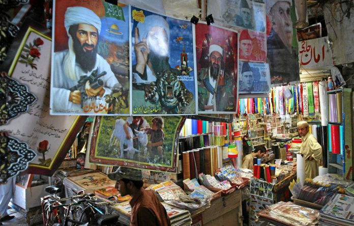 Images of slain al-Qaeda head Osama bin Laden are displayed for sale at a market in Quetta