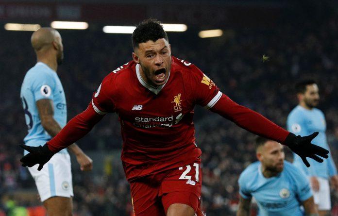 Liverpool's Alex Oxlade-Chamberlain celebrates scoring their first goal.