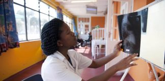 Medical student Inati Mcapazeli studies a chest x-ray at Cape Town's Brooklyn Chest Hospital on World TB Day 2012.