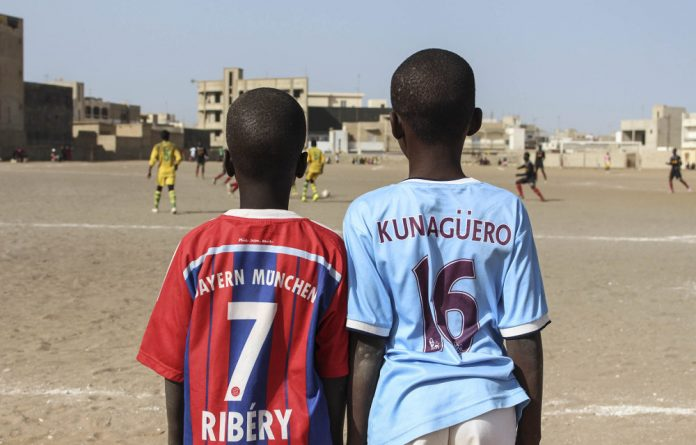 Euro heroes: The globalisation of football has led to boys in Dakar dreaming of playing for international clubs