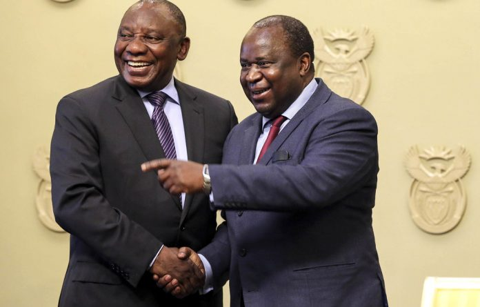 President Cyril Ramaphosa congratulates newly appointed Finance Minister Tito Mboweni