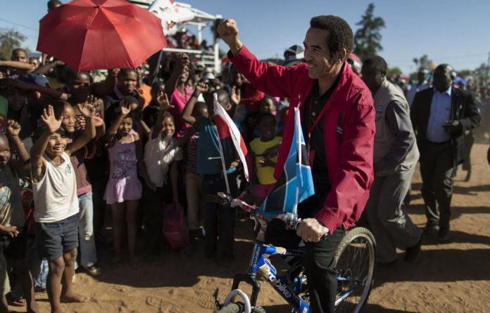 Populist move: President Ian Khama rides a bicycle while campaigning in Gaborone in 2014. But the gap between the people and the president has never been wider.