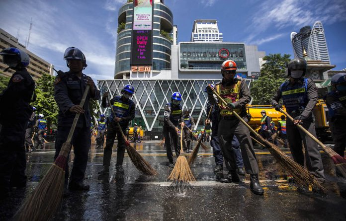 The bombing of a Buddhist shrine in Bangkok last week killed 19 people. It came as tension rises over indications that the election date may be delayed.