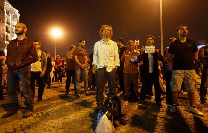 Turkish choreographer Erdem Gunduz stands on Taksim Square following what had been a lone protest.
