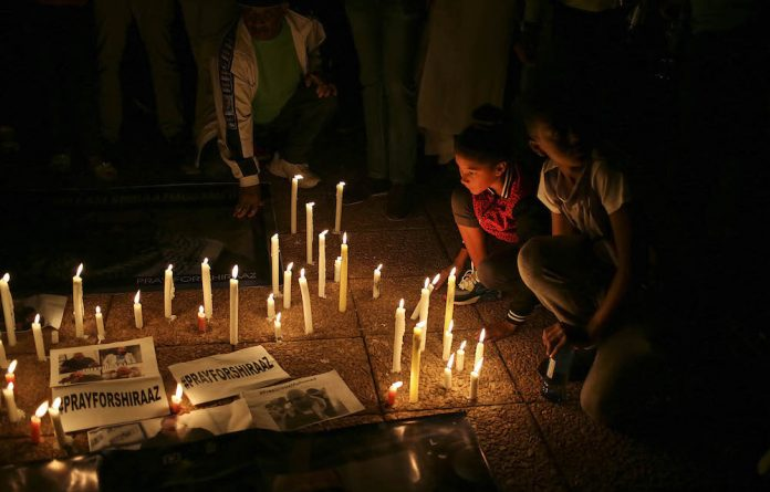 Still hope: Members of the community light candles during a vigil for kidnapped photojournalist Shiraaz Mohamed at the Lenasia South Civic Centre in Johannesburg. Photo: Alon Skuy/The Times/Gallo Images