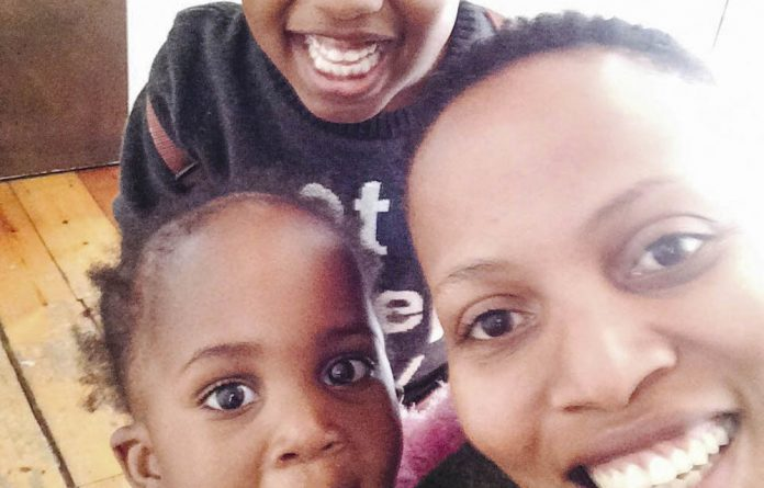 All smiles: Mathahle Stofile with her four-year-old son Zim and her one-year old daughter Lima.