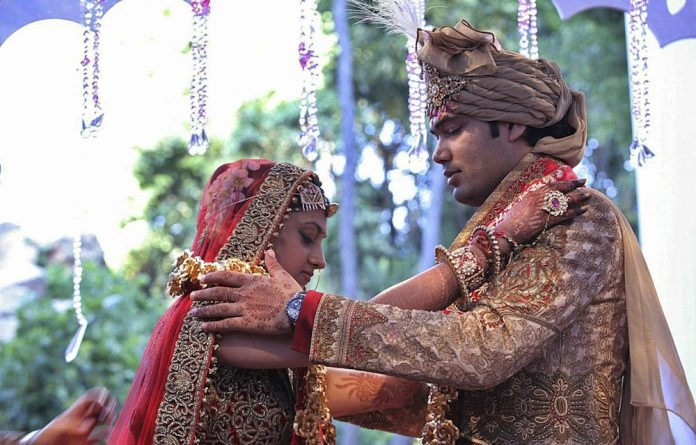 Family ties: Vega Gupta exchanges garlands with Aakash Jahajgarhia at their wedding