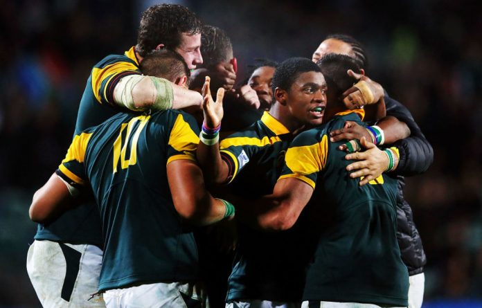 South Africa celebrate at the whistle after winning the 2014 Junior World Championship semi-final match between South Africa and New Zealand.