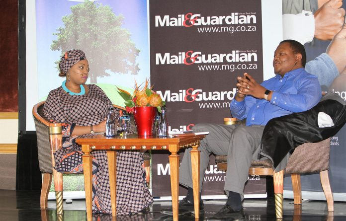 Moderator Tshepiso Makwetla shares ideas with ArcelorMittal South Africa chairman Mpho Makwana