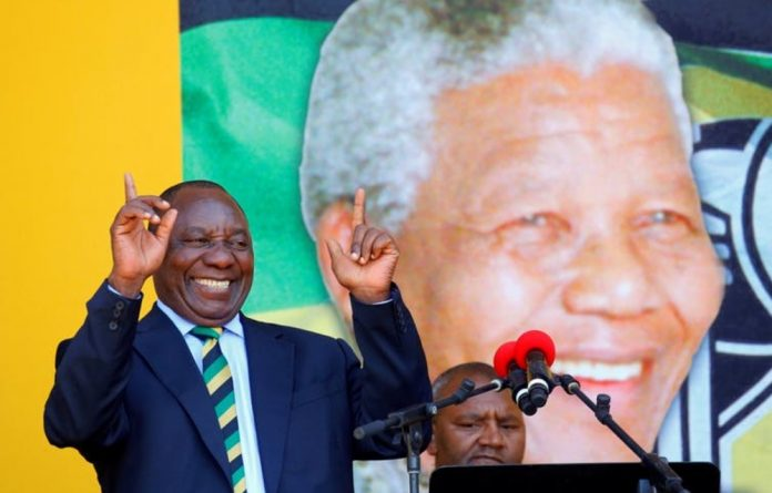 Cyril Ramaphosa addresses a rally to commemorate Nelson Mandela's centenary year in Cape Town
