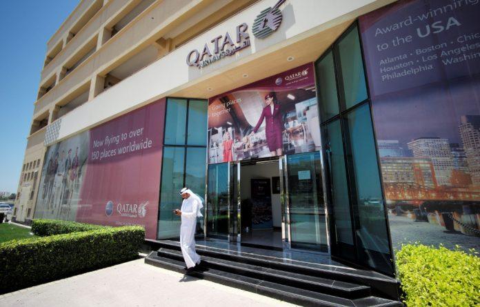 A man leaves Qatar Airways office in Manama