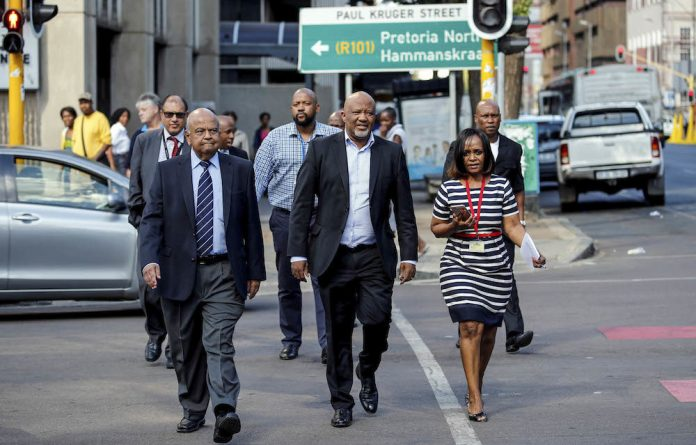 Defining moment: A determined Finance Minister Pravin Gordhan and his deputy
