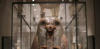 An Egyptian sarcophagus is displayed at the Museu Egizio
