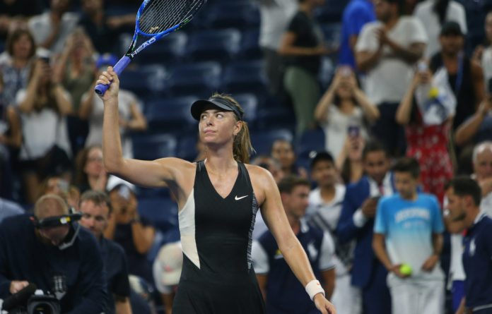 Maria Sharapova celebrates match point against Patty Schnyder in a first round match on day two of the 2018 US Open tennis tournament at USTA Billie Jean King National Tennis Centre.