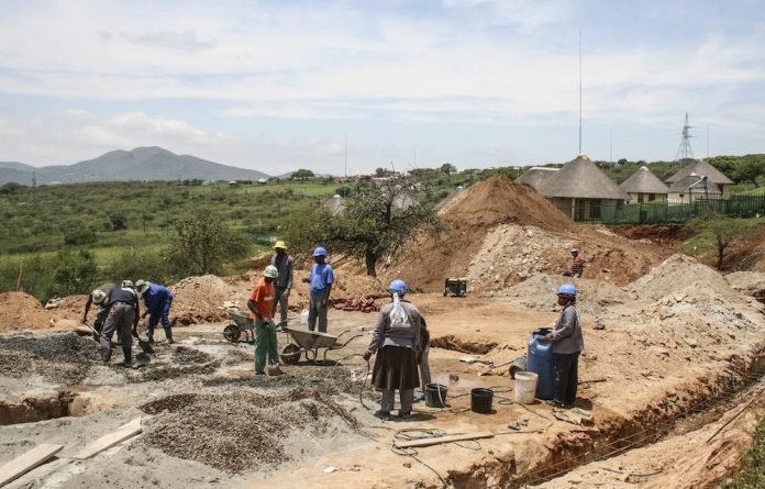 Construction workers conducting renovations in Nkandla.