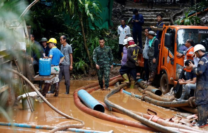 Soldiers and rescue workers work near Tham Luang cave complex in the northern province of Chiang Rai