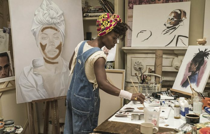 Loving: Nola Darling paints in her brownstone studio. Photos: David Lee/Netflix