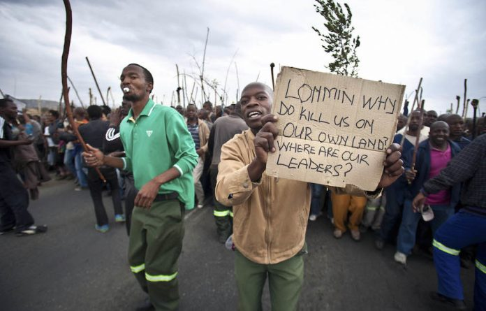 'itwelf koma five': Strike action in Marikana by mineworkers over pay increases. Some earned as little as R4?500