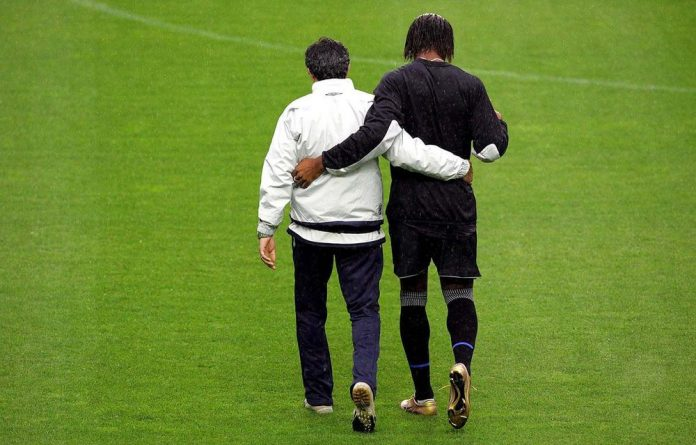 Didier Drogba and José Mourinho in deep discussion at a Chelsea training session.