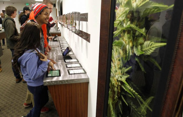 Growth market: Buyers browse in the Shango Cannabis shop on the first day of legal recreational marijuana sales in Portland in the United States.