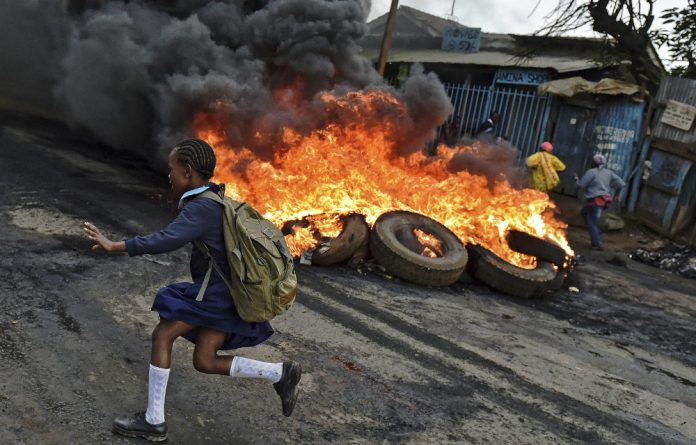 Burning issue: Opposition supporters set up a barricade in Kibera