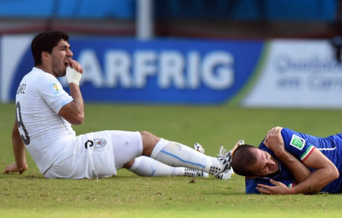 Uruguay's Luis Suarez after apparently biting Italy defender Giorgio Chiellini.
