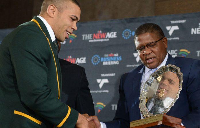Minister of Sports Fikile Mbalula honours Springbok player Bryan Habana.
