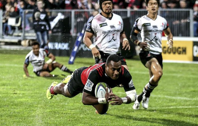 Captain's crusade: Manasa Mataele of the Crusaders dives to score a try in the Super Rugby match against the Sunwolves.
