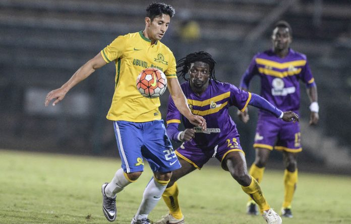 All in vain: Leonardo Castro of Sundowns and Paul Aidoo of Medeama during the first leg