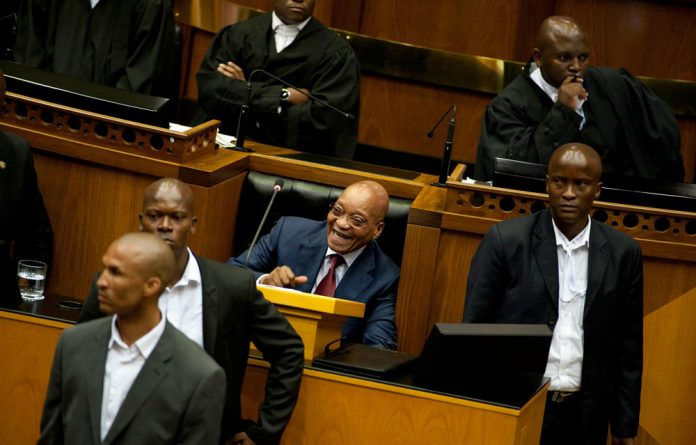 President Jacob Zuma laughs after EFF MPs were forced to leave the house.