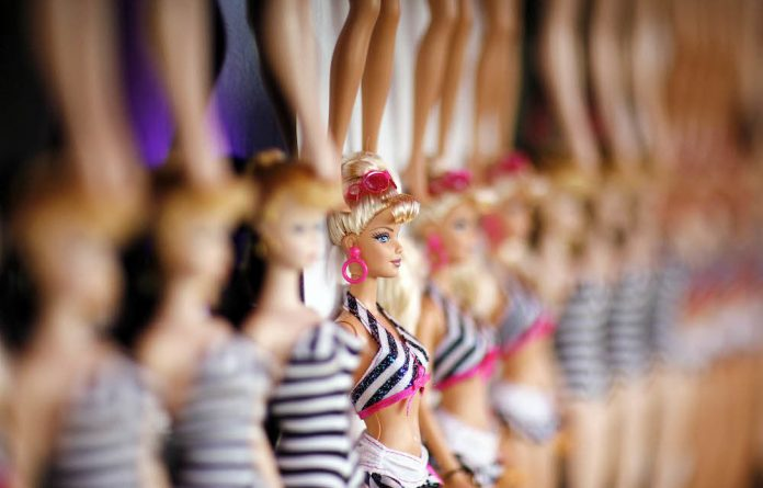 Empowering: The new Barbie doll allows little girls to act out their dream jobs.