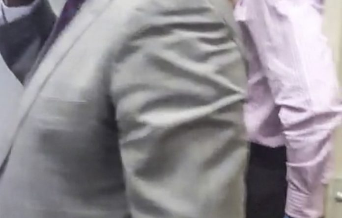 Visual evidence: A video screen grab of  Tom Moyane's bodyguard